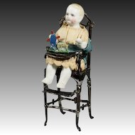 Antique Metal High Chair with Seated All-Bisque Baby