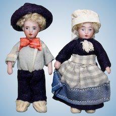 Pair of Antique All-Bisque Tiny Mignonettes in Original Costume