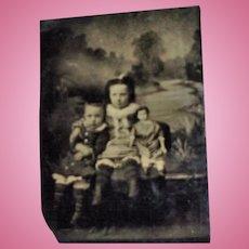 Antique Tin Type Children Holding Paper Mache Greiner Doll