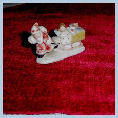 Marked Germany Snow Baby Santa with Sled and Toys