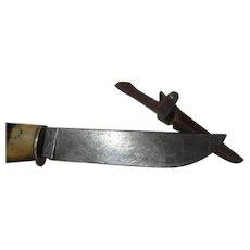 Vintage old Remington hunting knife and sheath Model number 73