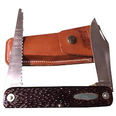 Vintage Western folding knife in leather sheath Colorado made model 932-H Bear on blade plus saw blade
