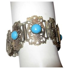 Silver-Toned Filigree Bracelet with Faux Turquoise Stones and Hamsa Charm
