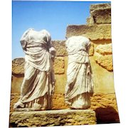 Original Colored Photograph-Ethnographic Exterior Landscape of Headless Statues of Cleopatra and Dioscurides, Cyclades, Delos Island, Greece by Bernard Levere