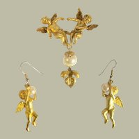 Double Cherub Brooch and Earring Set by Jonette Jewelry Company (1988)