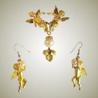 Double Cherub Brooch and Earring Set by Jonette Jewelry Company (1988)