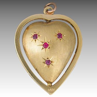14 Karat Yellow Gold Reversible Heart Shaped Charm/Pendant set with Rubies and Sapphires