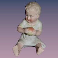 Old Doll Bisque Piano Baby Figurine Sweet Holding Apple
