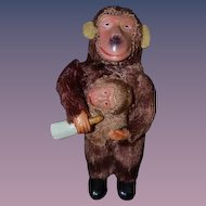 Old Miniature Wind Up Monkey Feeding Baby Doll