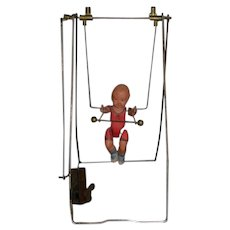 Old Celluloid Doll Wind Up Trapeze Artist On Metal Form