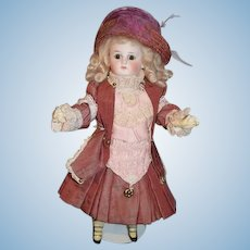Antique Doll Sonneberg Closed Mouth Flange Neck Fancy Clothes Cabinet Petite Size