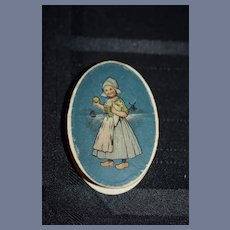 Old Wonderful Miniature Oval Box Litho W/ Dutch Girl and Pink Tinted All Bisque Doll inside