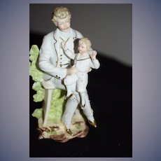Wonderful Porcelain Bisque Man W/ Child Doll on Lap Figurine Piano Baby