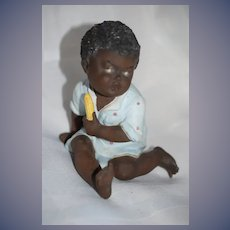 Old Heubach Figurine Piano Baby Doll Black Crawling Baby