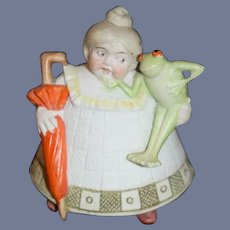 Old All Bisque Lady Character Doll Holding a Frog