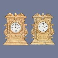 Two Miniature Gold Clocks