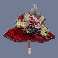 Red Velvet Doll Hat With A Green Bow and Blue Feather