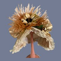 Beautiful Rose Gold Silk Doll Hat with Flowers, Feathers, and Lace Details