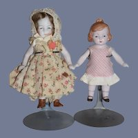 Two Small All Bisque Sister Dolls