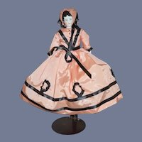 China Head Doll in Pink and Black Cloth Dress