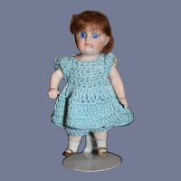 Miniature All Bisque Doll Wearing Blue Knit Outfit
