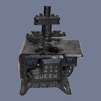 Miniature Black Metal Stove with Pots and Pans