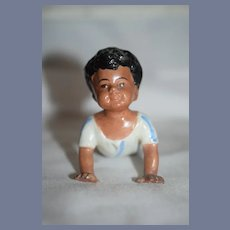 Old Doll Figurine Black Piano Baby Crawling In Pajama's