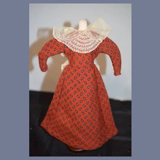 Red Fabric Doll Dress with Lace Detailing on Back
