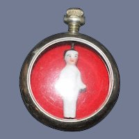 Miniature Frozen Charlotte inside Miniature Watch Case