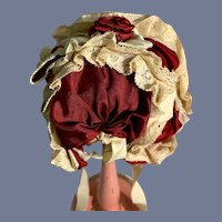 Fancy Red Cloth Doll Bonnet with Lace Detailing