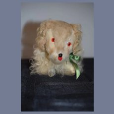 Old Stuffed Dog Toy with Orange Plastic Eyes and Green Ribbon Bow