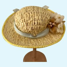 Small Straw Hat with Blue Ribbon and Flowers