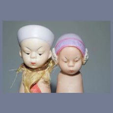 Set of Two Oriental All Bisque Dolls Missing Arms Marked QUEUE SAN BABY on one