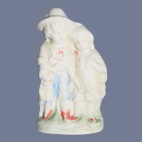 Old Porcelain Boy and Girl Figurine