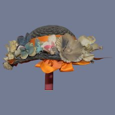Unique Gray Straw Doll Bonnet with Orange Ribbon and Flower Filled Brim