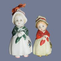Pair of All-Miniature Painted Bisque Bobblehead German Girls