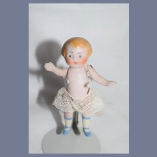 Miniature Painted All Bisque Baby with Lace Shorts and Blue Shoes