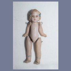 Miniature All Bisque Jointed Doll with Blue Hair Bows