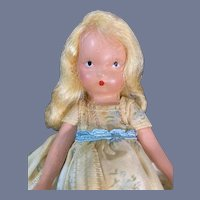 NASB Painted Bisque Doll in White and Blue Flower Print Dress