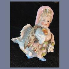 Porcelain Figurine Holding a Goose