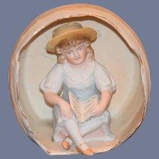 Old Doll Child Figurine Piano Baby Bisque Child in Barrel w/ School Book