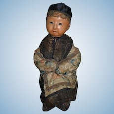 Antique Doll Glass Eye Oriental Doll Sitting  Child Wax over Papier Mache Paper Original Clothing Pierced Nostrils