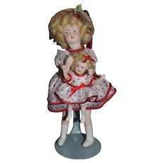 Miniature Shirley Temple Doll holding a Shirley Temple Doll Miniature Dollhouse Artist Signed