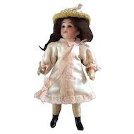 "Beautiful 7"" German bisque head doll"