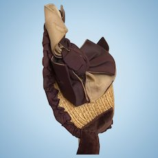 Dark brown silk and golden brown straw bonnet