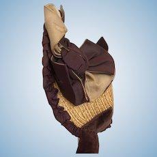 Dark brown silk and golden brown straw Jumeau bonnet