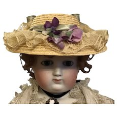 A gorgeous handmade straw summer chapeau for poupee or Bebe doll