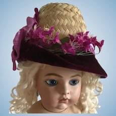 Asymmetrical straw hat, trimmed purple and magenta for large doll