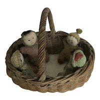 Antique / vintage 4 tiny crochet dolls seated in a wicker basket