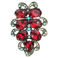 Large Eisenberg Original dress clip with huge cranberry red stones